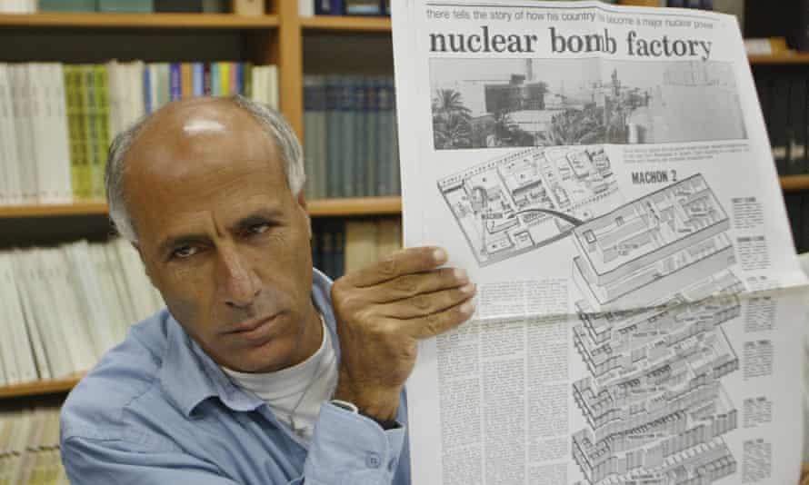 Vanunu holds a copy of the original newspaper in which he revealed Israel's nuclear secrets, in Jerusalem, 2004.