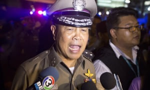Somyot Poompanmoung talks to the media near the site of the explosion.