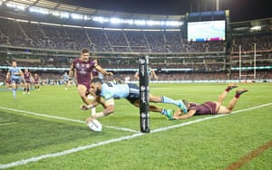 Josh Addo-Carr dives over after James Tedesco's decisive break. (Photo by Scott Barbour/Getty Images)