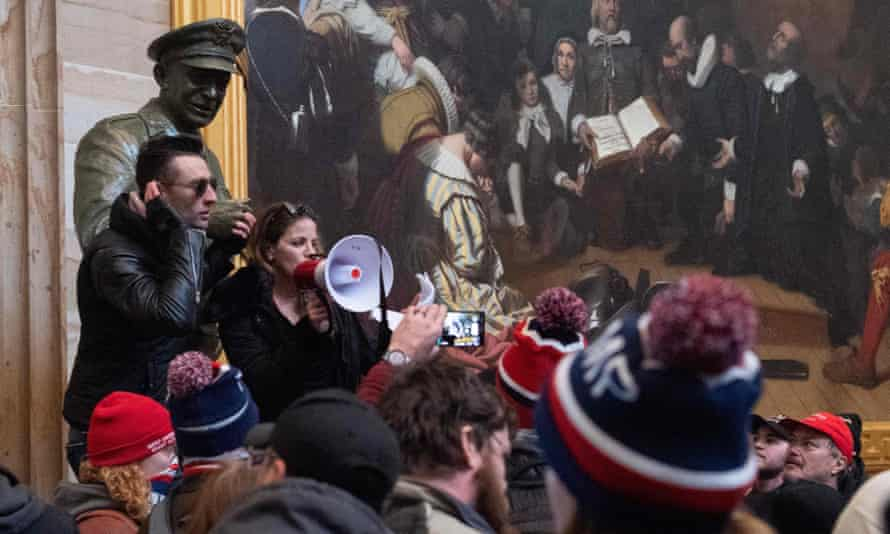 Supporters of Donald Trump, including Dr Simone Gold, protest in the US Capitol Rotunda on 6 January 2021 in Washington DC.
