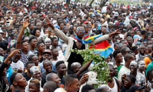Felix Tshisekedi's supporters celebrate outside the party's headquarters in Kinshasa.