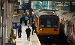 Northern rail passengers and train in Manchester