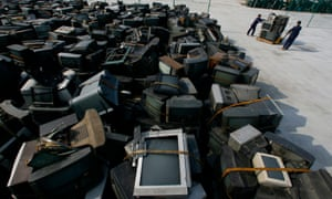 Workers at an electronic waste recycling factory in Jingmen, Hubei province.