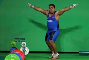David Katoatau of Kiribati dances off the weightlifting platform.