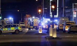 Police vehicles in the area of London Bridge after an incident in central London on Saturday night