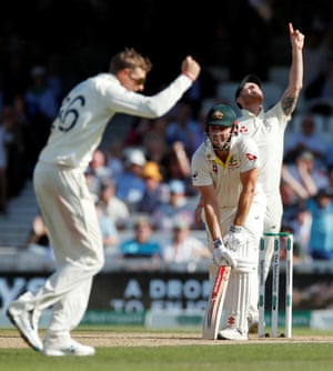 Australia's Mitchell Marsh looks dejected after being caught out by England's Jos Buttler off the bowling of Joe Root.