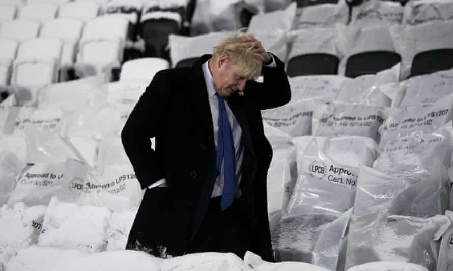 Boris Johnson walks past seats after an official switching on ceremony of the floodlights at the London 2012 Olympic stadium in 2010.