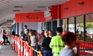 Shoppers seen waiting outside a Coles supermarket in Adelaide on Monday.