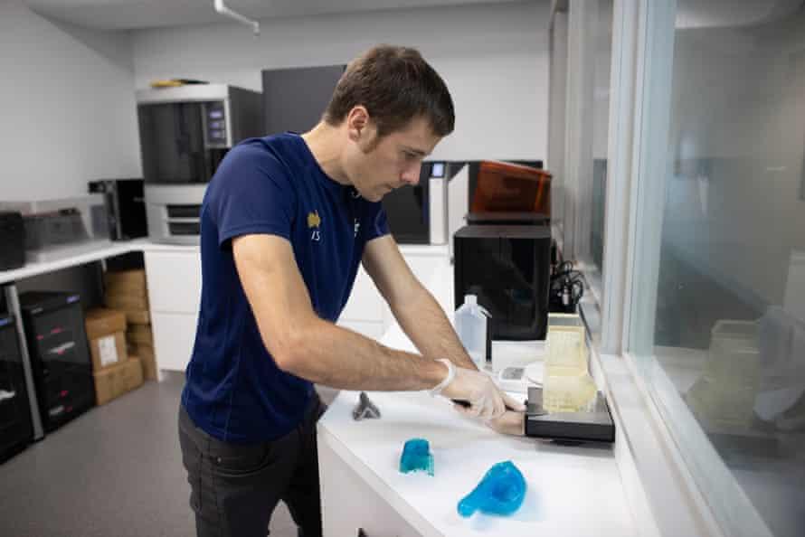 AIS engineer Callum McNamara at work in the institute's 3D printing room.