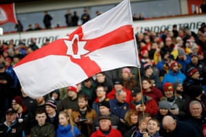 A young fan waves the flag of Northern Ireland during the European Champions Cup group-stage match against Racing 92 at the Kingspan Stadium in Belfast.
