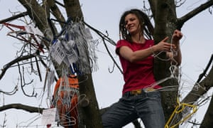 A woman hangs up hangers, symbolizing illegal abortion, in Warsaw earlier this month. 'I don't think women in Poland ever used hangers,' said one activist.
