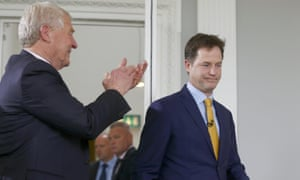 Former Lib Dem chief Paddy Ashdown (L) applauds Nick Clegg at a press conference where he announced his resignation as leader.