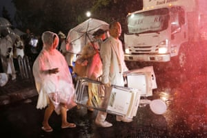 New York, US Attendees evacuate as heavy rain falls at the Diner en Blanc dining event in New York