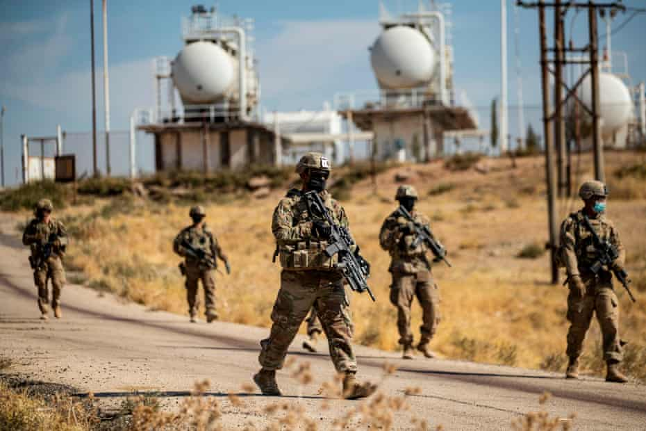 US soldiers on patrol near an oil production facility near al-Malikiyah, Syria on October 27, 2020.