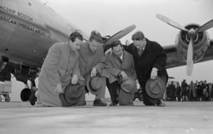 Billy Graham (second left), kneels with other clergy before flying to Europe to represent the Youth for Christ Movement, and spread the gospel.