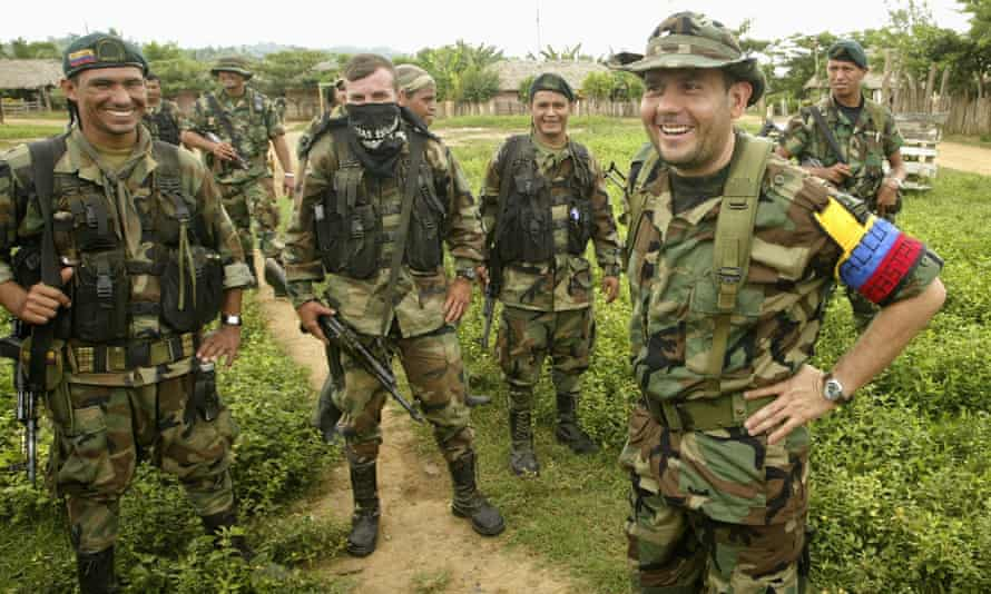 Carlos Castano, Colombia's far-right warlord, talks with his fighters in a secret location in the northwestern Colombian mountains on 5 September 2002.