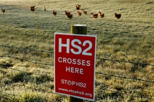 A poster protesting against a proposed high speed rail project linking London with northern England (HS2) is nailed to a fence on a field near Lymm, northern England, March 25, 2015.