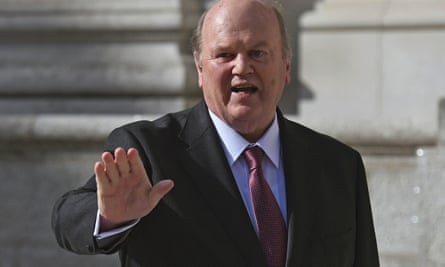Michael Noonan gestures on the steps of Government Buildings in Dublin