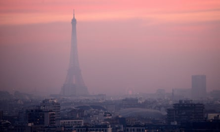 The Eiffel Tower is shrouded in smog