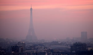 The Eiffel Tower clouded by high levels of air pollution in Paris, France