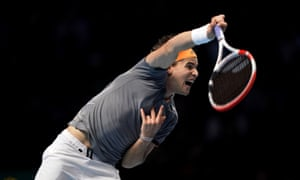 Dominic Thiem slams down a serve on his way to victory over Roger Federer on day one of the Nitto ATP Finals in London.