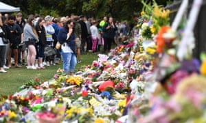 Members of the public place flowers at a makeshift memorial for the victims of the mosque mass murders at the Botanical Gardens in Christchurch, New Zealand