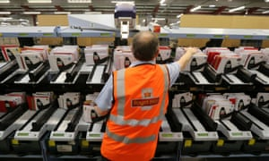 Postal worker sorting mail in Glasgow