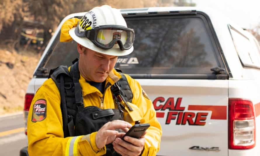 Joseph Gibson, deputy state fire marshal, adds destruction details to a Cal Fire app on Saturday after inspecting a structure hit by the Dixie fire.