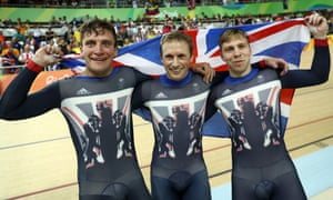 Callum Skinner, Jason Kenny and Philip Hindes of Great Britain celebrate after winning gold and getting an Olympic record in the Men's Team Sprint.