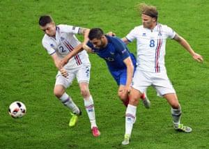 Andre-Pierre Gignac tries to squeeze through Iceland's Birkir Bjarnason and Birkir Saevarsson.