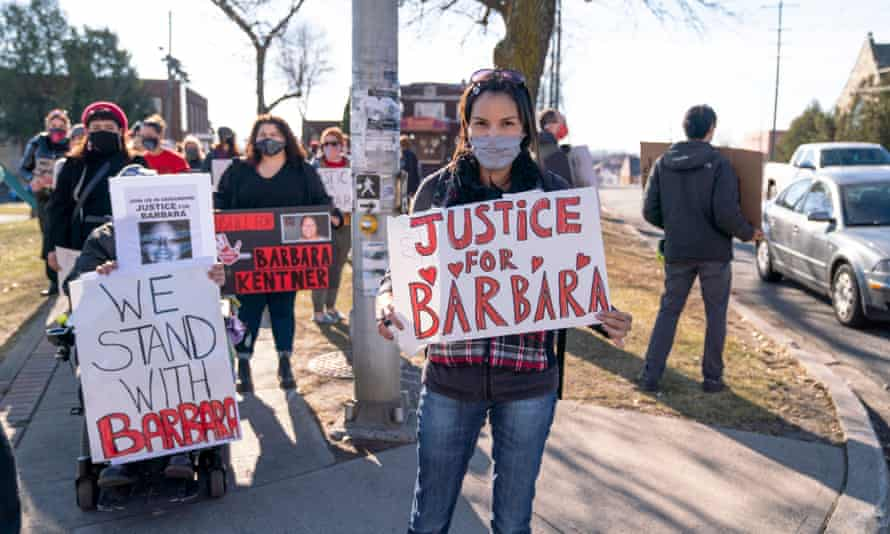 Demonstrators hold signs on the second day of Brayden Bushby's trial in Thunder Bay, Ontario, on 3 November.