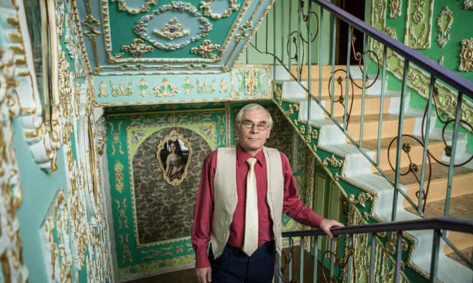 Vladimir Chaika poses in the stairway of his apartment building in Kiev