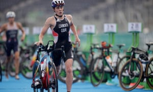Jessica Learmonth begins the cycling leg amid sodden conditions in Tokyo.