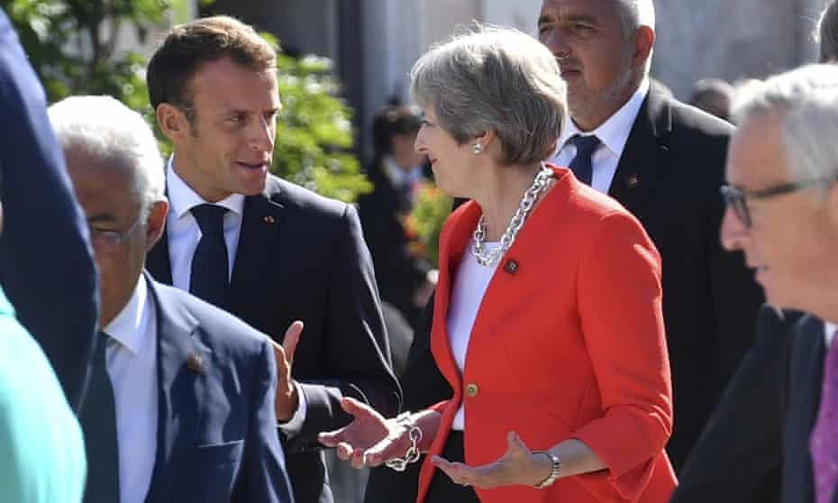 Emmanuel Macron, left, with Theresa May in Salzburg.
