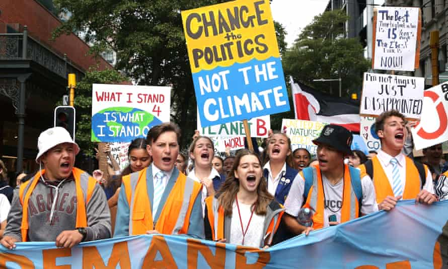 Students march through the streets during a strike to raise climate change awareness on 15 March in Wellington, New Zealand.