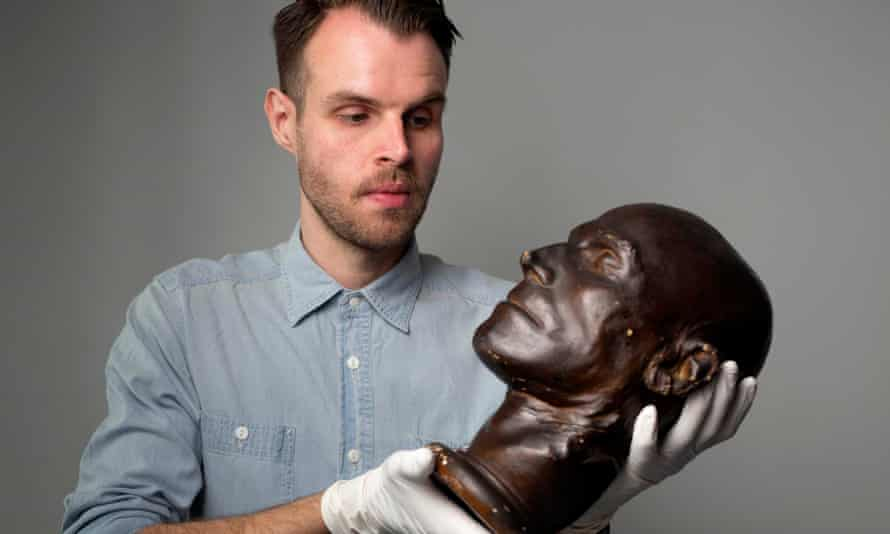 John Readman with the death mask of Daniel Good, from the Crime Museum Uncovered exhibition.
