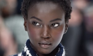 A Chanel model with rouged cheeks at Paris Fashion Week.