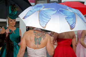 Umbrellas were a much-needed accessory on a cold and wet Ladies' Day