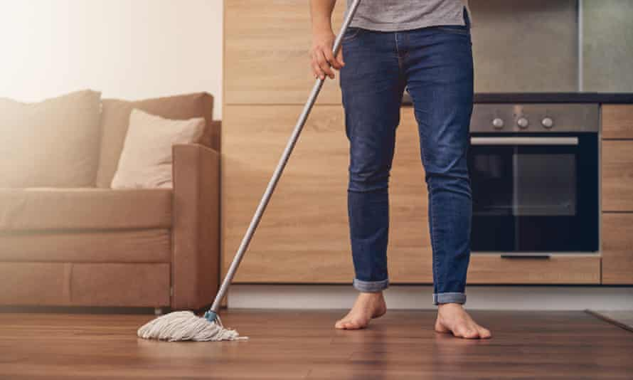 Man washing floor in living room