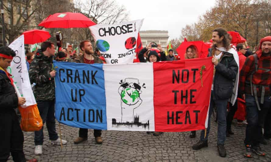 """Activists protest during the Paris talks. 'The festival of self-satisfaction with which the talks ended was a """"mission accomplished"""" moment, a grave case of premature congratulation.'"""
