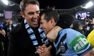 NSW coach Brad Fittler celebrates with Mitchell Pearce
