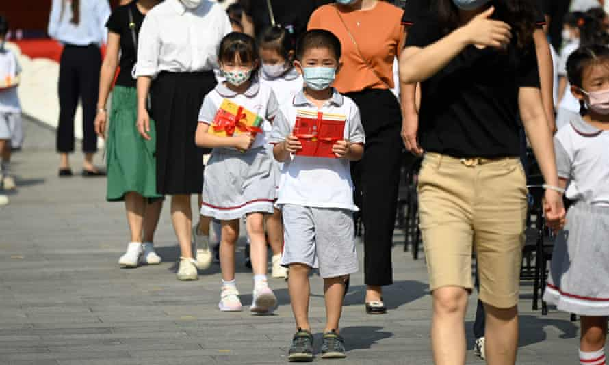 Primary school children arrive for the first day of the new school year in Beijing. The Chinese president's political ideology, known as Xi Jinping thought, will be included in the school curriculum.