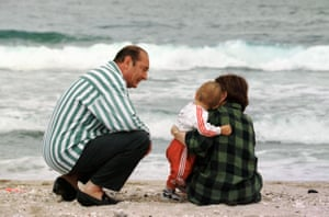 On the beach with his daughter, Claude, and her baby son in 1997