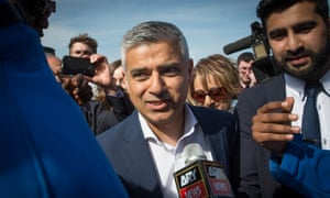 Labour mayoral candidate Sadiq Khan arrives at City Hall in London.
