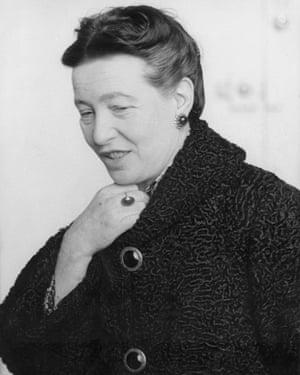 Simone de Beauvoir in the black Persian lamb coat she brought back from Russia.
