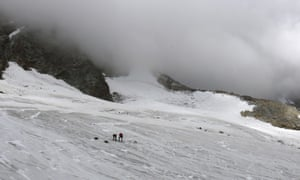 Police investigate the site where the body of a German hiker was found in the Valais canton near Saas-Fee, Switzerland.