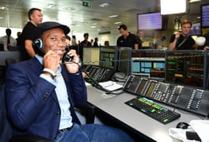 Footballer Didier Drogba striking a deal