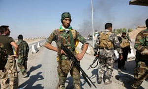 Iraqi forces patrol in the streets after they retake the control of the city center from peshmerga forces in Kirkuk, Iraq, on Monday.