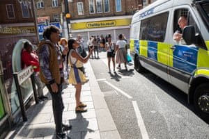 Locals remonstrate with members of the Metropolitan Police's Violence Suppression Unit after youths, suspected of committing a crime, were apprehended on the street in West Croydon, south London.