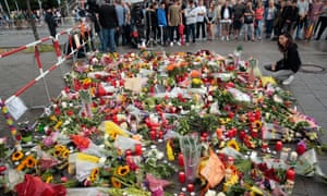 Floral tributes left at the crime scene after a shooting spree that left nine people dead in Munich.